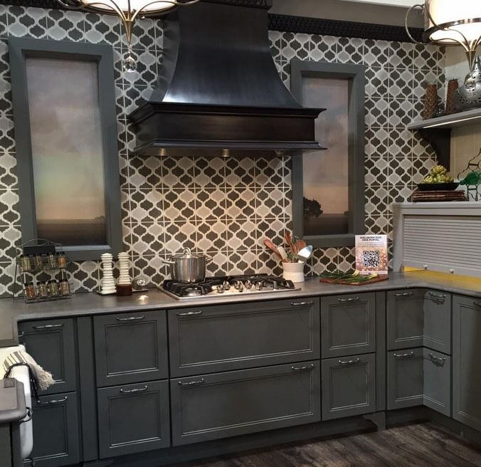 Cream cabinets with dark countertops with white cabinets