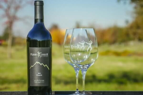 Perry Creek wine bottle and wine glasses
